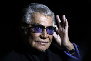 File photo of designer Roberto Cavalli acknowledging the audience at the end of his Spring/Summer 2014 collection during Milan Fashion Week
