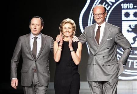 Gildo, Anna and Paolo Zegna acknowledge applause at the end of the Ermenegildo Zegna Fall/Winter 2010/11 Men's collection during Milan Fashion Week
